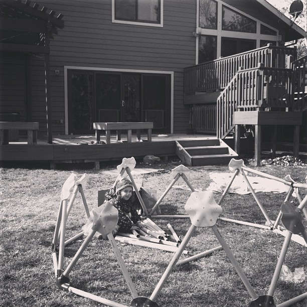 Nyla excitedly awaiting construction of the geodesic dome.