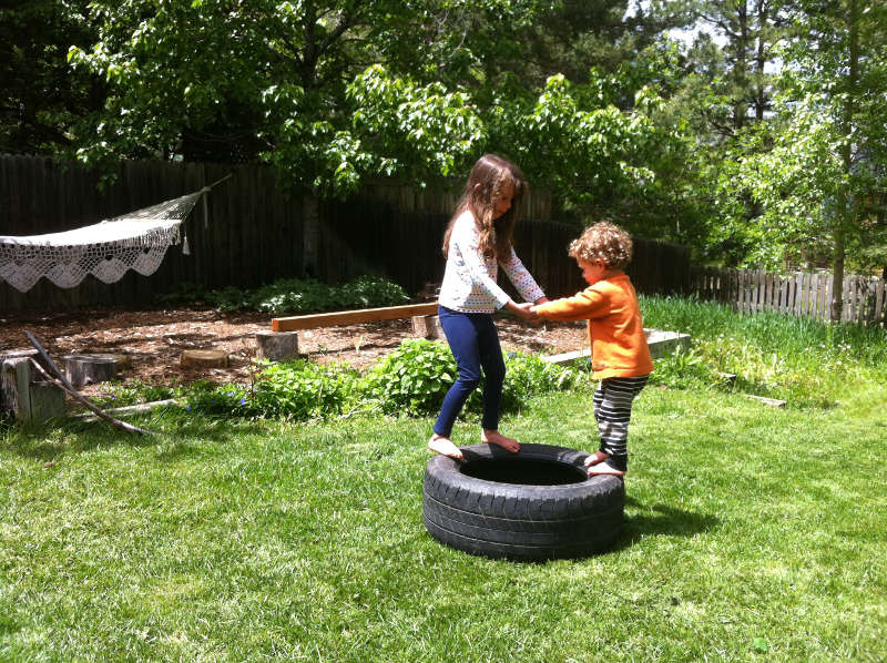 Nyla and Silas getting acquainted with the car tire newly set in our backyard.