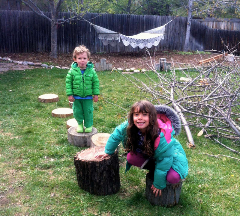 Nyla and Silas enjoying some locomotive play on a series of stumps.
