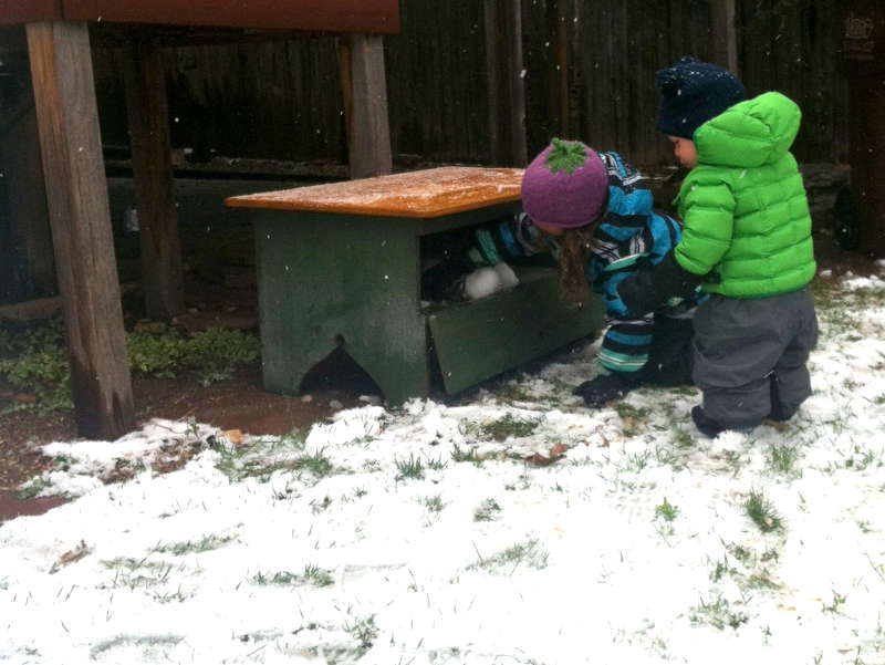 "Nyla and Silas placing ""snow"" balls in the newly acquired oven during a spring snow day."