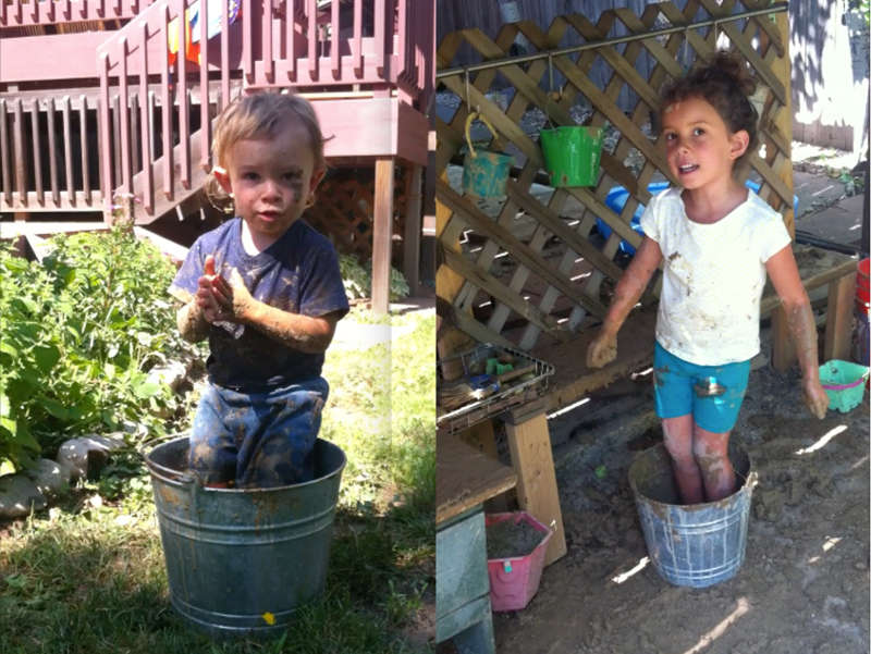 Silas washing his hands while sitting on the lip of a galvanized bucket. Nyla joining in the fun and dancing in the bucket of mud.