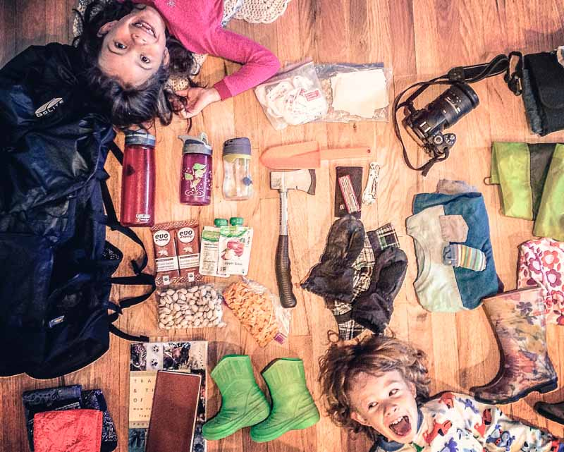 Nyla and Silas in their best goofball pose as we're gathering gear for a family nature club event.